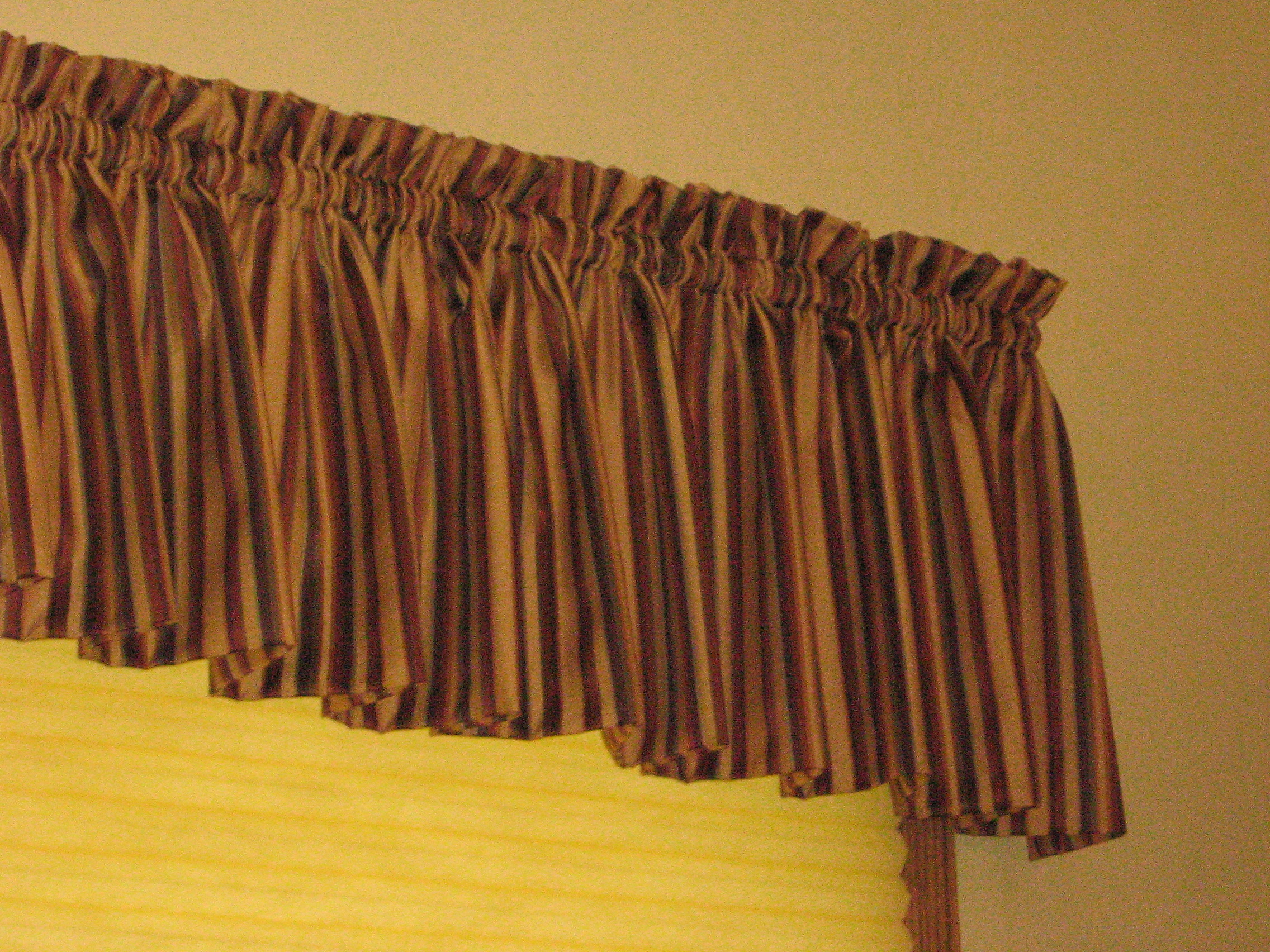 What is a valance and how is it different than a cornice a little
