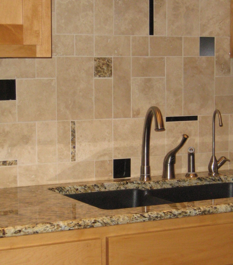 Custom limestone backsplash