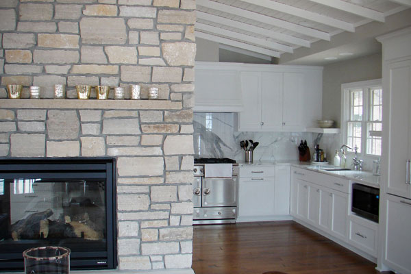 beachy cottage fireplace and kitchen