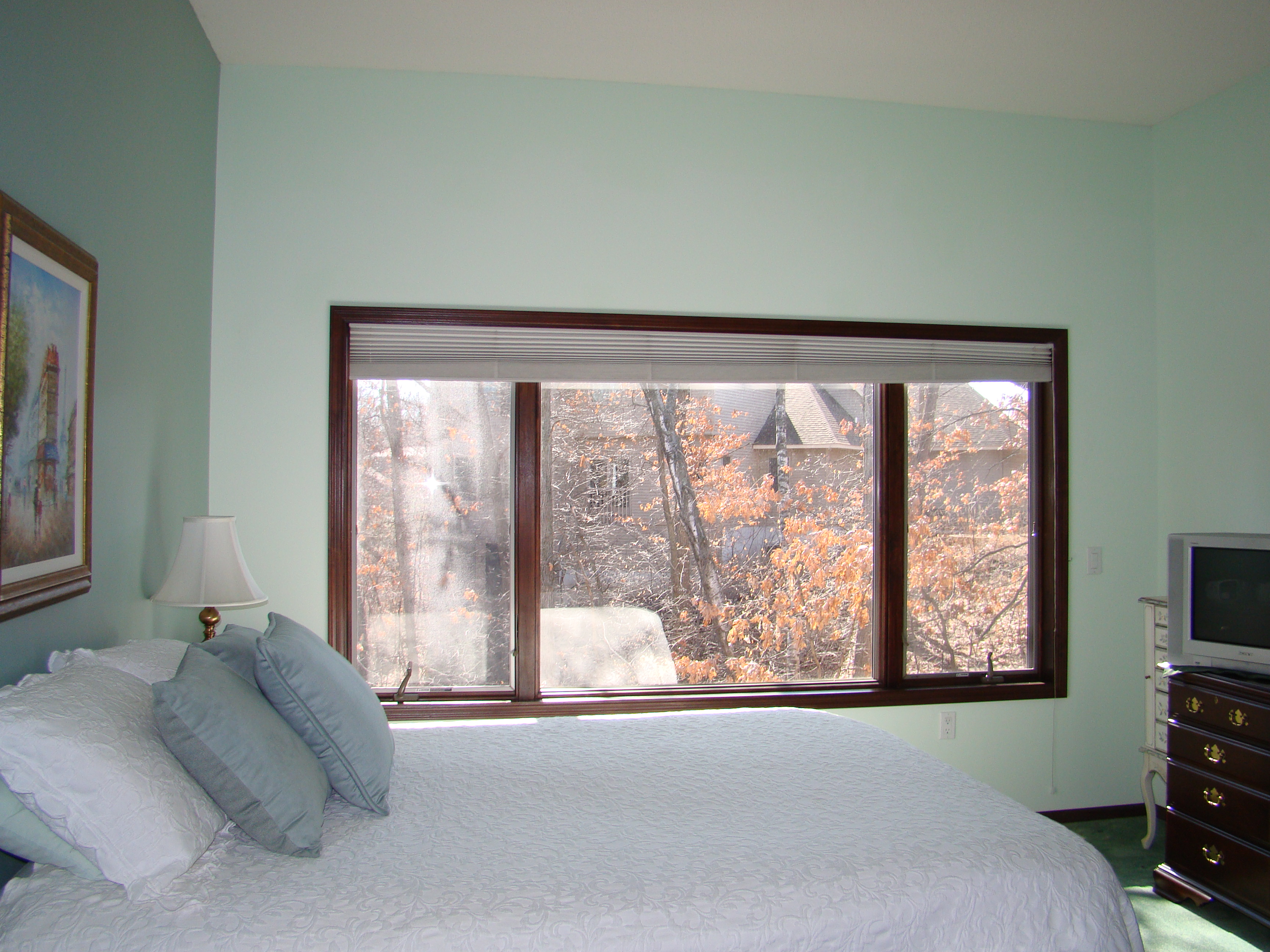 Before after window treatments that camouflage a for Bedroom window treatments