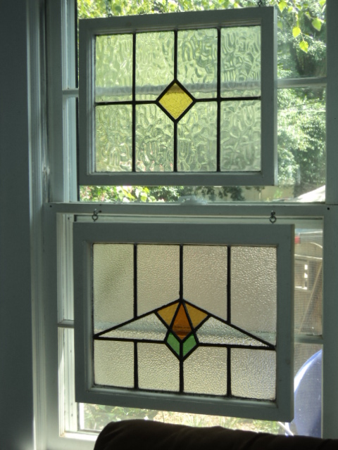 stained glass hung in front of window